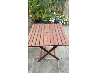 Solid Jarrah wood garden table, near new