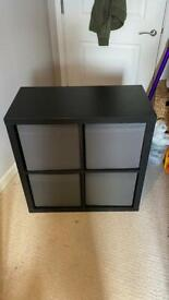 IKEA Kallax storage unit with boxes