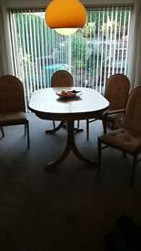 Extendable soild dining table and 4 chairs