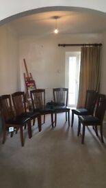 6 mahogany dining chairs, new condition, black leatherette padded seats