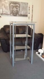 Matching glass, steel and chrome, display stand , coffee table , TV stand, and side table