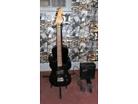 3/4 size elecric guitar c/w amp strap + lead and 3/4 size acoustic guitar will sell seperate