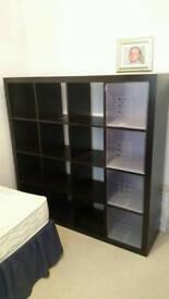 Dark brown cabinet shelving