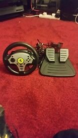 Steering wheel with pedals. Good condition.