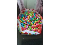 large ball pool /pit with 4 black bags of balls
