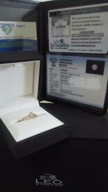 18 carat gold with certified solitaire diamond