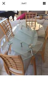 Unusual Glass dinning table four chairs