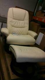 A brand new cream massage arm chair with heated pad on the back.