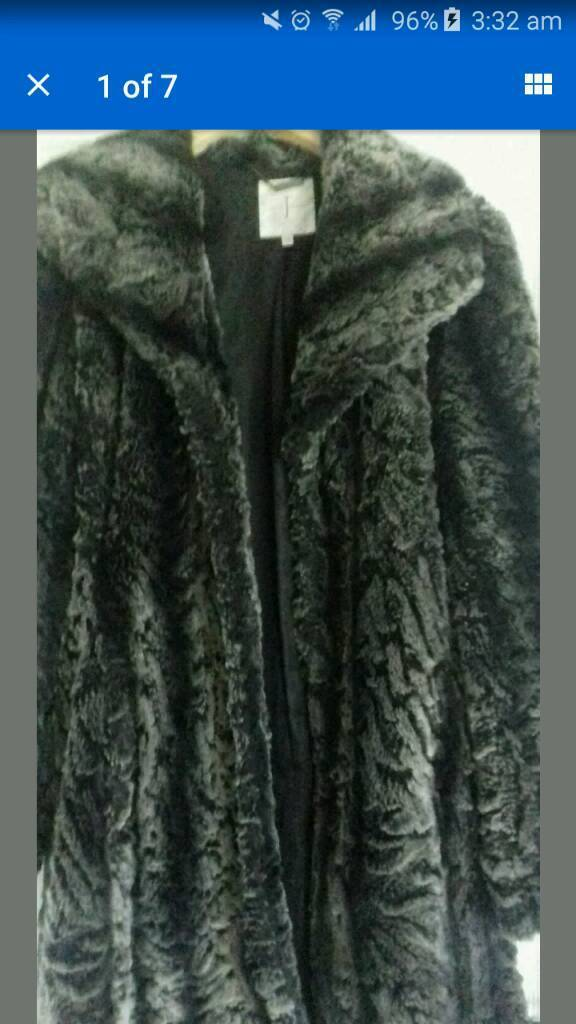 Jasper conran fur coatin Rowlands Gill, Tyne and WearGumtree - Lovely fur coat black/grey size 14 2 side front pocket large full coller leather type tie belt can be worn with or without. used still nice condition