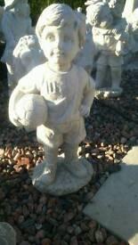 Concrete football boy garden ornament