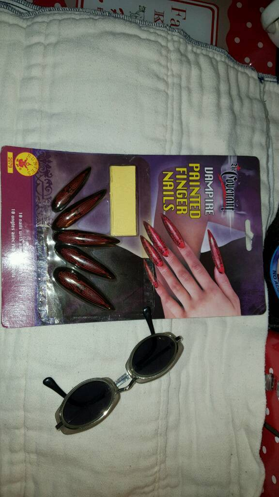 Halloween... vampire nails and glasses