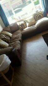 Corner sofa with poof