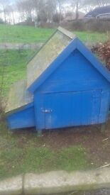 Wooden chicken coop. Would fit up to six hens