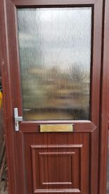 Upvc rose wood front door with top glass panel ref 1