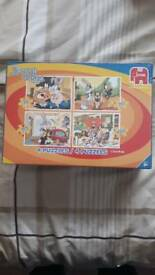 Brand new and sealed Looney Tunes puzzles