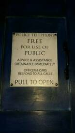 Tardis chair. Police box sign on a totally plain blue office style chair.