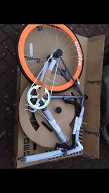 Brand new quella one graphite fixie bike in box, only opened the box. Frame size is 54cm