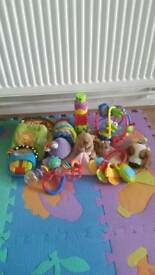 Baby toys books and rattles