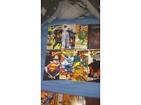 lots of superman comics and graphic novels