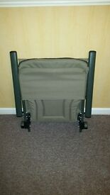 Prologic fishing chair with arm rests.