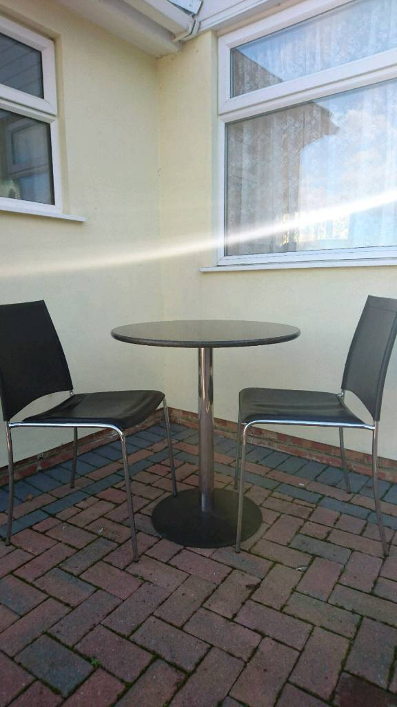Marble top table and two chairs