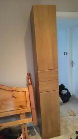 Tall slim medium brown wooden wardrobe