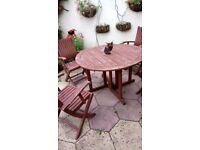 Garden table and four matching chairs and free cushions