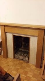Fire surround with double sided back panel
