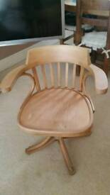 Pine captins style swivel a justable chair..