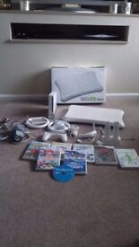 NINTENDO WII FIT PLUS BUNDLE.CONSOLE+WII FIT BOARD+GAMES+ STEARING WHEELS+CONTROLLERS ETC