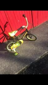 Kid's green and black bike in excellent condition with stabilisers. Great for a child's first bike.