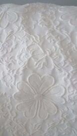 Cream bedspread and pillow shams