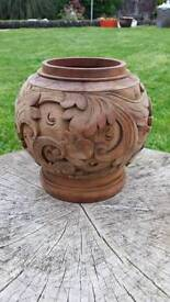 A beautiful hand carved wooden bowl with floral design
