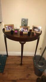 Half moon mahogany table