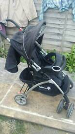 Black and silver pushchair with raincover