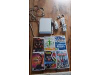 Wii console with games and balance board