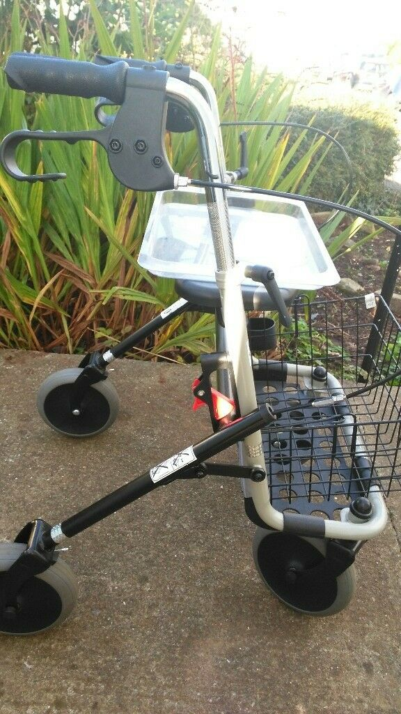 Invacare 4 wheel walker with a basket and tray-used only indoors