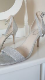 Silver sequin sandals and cluth bag