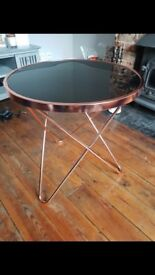 Black and rose gold tempered glass coffee table