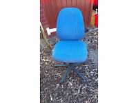 Office chair covered with blue material