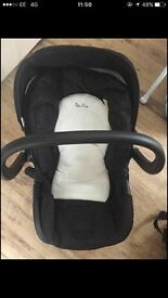 Black and white silvercross baby seat