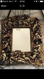 Beautiful mirror - plaster reproduction cherub mirror in gold leaf