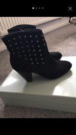 Black Jessica Simpson boots by Kurt Geiger