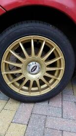 """15"""" motorsport team dynamic gold alloys with tyres"""