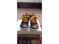 Clarks Brown pull on and zip up boys boots size 4 1/2 G. used but in good condition.