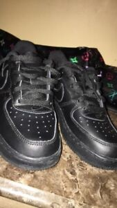 Pair of black nike air force 1 low