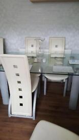 Solid glass table and 4 chairs