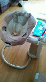 Graco baby swing/rocker plays music and has phone connector
