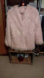 Pretty Little Thing fur jacket.