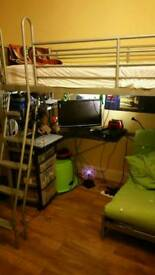 Desk bunk bed with integral ladder and futon